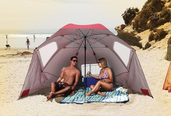 A beach umbrella that will create a shady spot for you to lie in the sand.