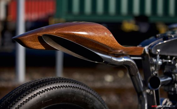 A wood seat! As long as it was reinforced I would do  Enfield by Maxwell Hazan