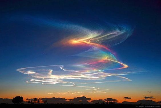 "Amazingly beautiful natural phenomenon can be observed when the sun rises high in the sky. The rays of the sun when it passes through high-altitude clouds composed of ice crystals in the form of hexagons. The sunlight is refracted in these crystals in bizarre way, and as a result, we see ""fire rainbow"". This phenomenon is not local, it can extend over several hundred square miles"
