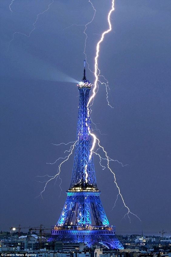 Ameteur Photo­grapher Bertrand Kulik shot a spectacular photo of lightning striking behind the Eiffel Tower in Paris in July 2008.