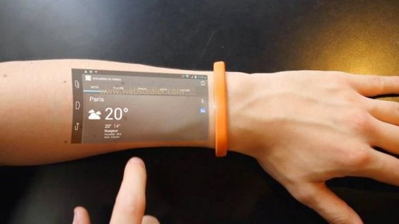 An Android powered smart bracelet forgoes the tiny display of a typical smartwatch and projects a smartphone-size touchscreen onto the skin
