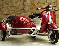 - Piaggio Vespa Scooter and Sidecar