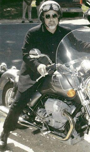 Billy Joel on a Moto-Guzzi motorcycle