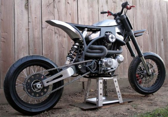 Buell motor, minimalist frame, and supermoto suspension.  I like it.