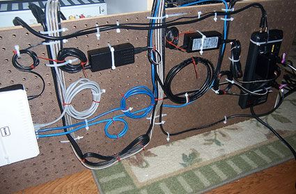 cable management using pegboard + tie wraps (attach to underside/backside of furniture)