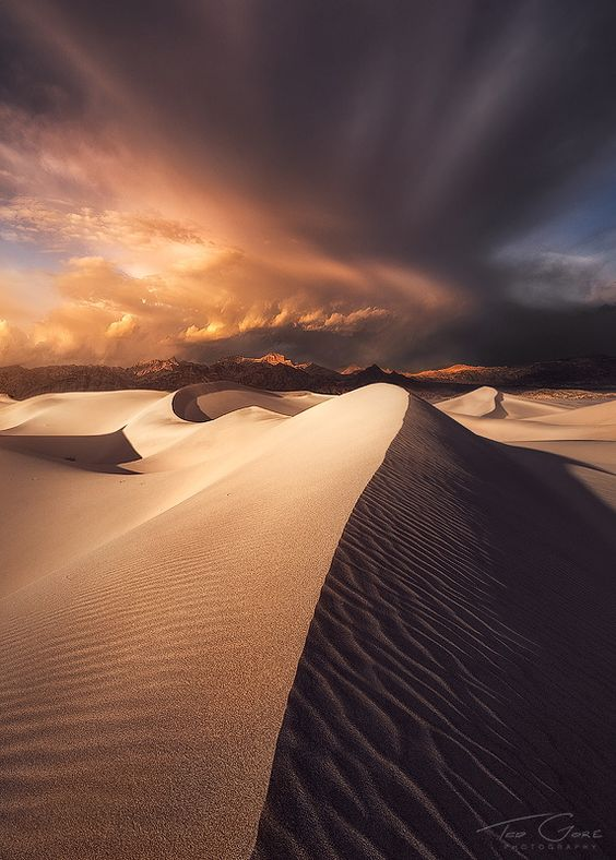 ~~Hourglass   an impressive cloud formation passes over the Mesquite sand dunes in Death Valley National Park, California by Ted Gore~~