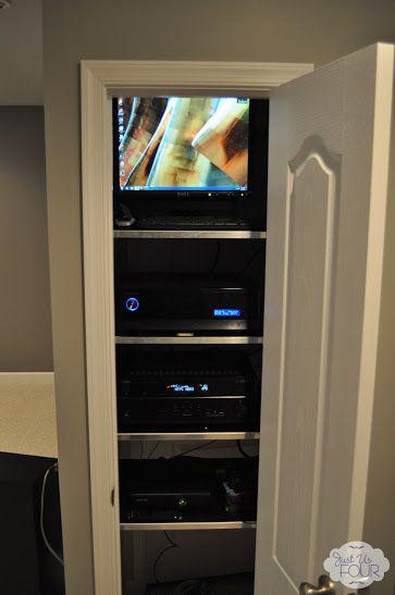 Media Closet Build into basement bathroom for TV above fireplace