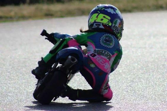 Mini moto racing… a little girl sporting a Rossi '46' AGV helmet, full leathers, getting her knee down! How amazing is