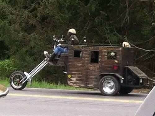 Motorcycle Stage Couch with a little kick. I could go West in that. Would make one heck of a get away camper for weekend outings. I love any custom trike or chopper.
