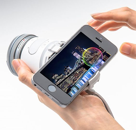 Olympus AIR - Olympus just unveiled the AIR Camera, a handheld interchangeable lens camera completely controlled with smartphones. Olympus wedged the mirrorless, wi-fi & Bluetooth-enabled, 16-megapixel camera—its sensor, storage, battery, & camera functio