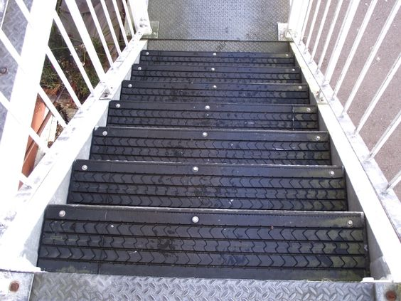 re-use tires for no slip stairs. would be neat for garage to house stairs or loft stairs in an outbuilding