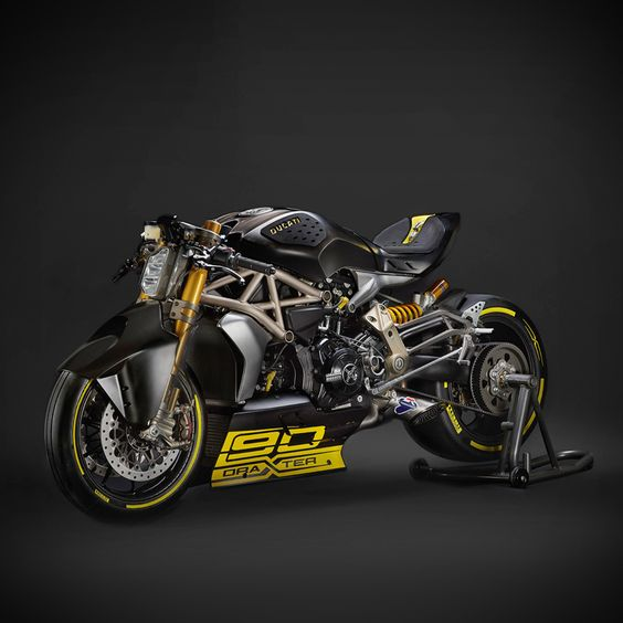 The Ducati draXter is a dragster-based concept motorcycle based on the new XDiavel cruiser. Raiding the parts bin, Ducati's Advanced Design unit picked out the Panigale's suspension and braking components—and then the stylists took the bodywork to the extremes. The swooping line from front fender to tail is exquisite, and we can't think of a more entertaining way to melt 240-series rubber.