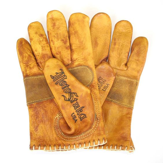 The MotoStuka Shanks gloves are a hand finished motorcycle glove in distressed leather. They are treated with an all natural balm which leaves them resistant to water and are finished out with waxed thread and since they are hand finished every pair is unique with a rich coppery patina.