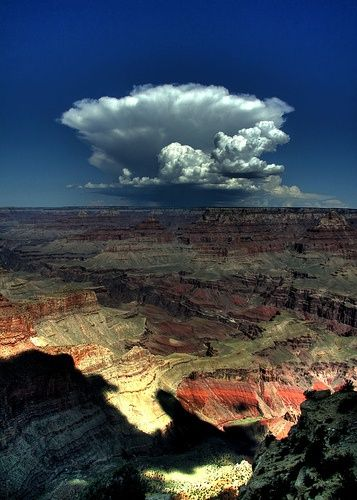 This picture was taken from the South Rim of Grand Canyon. Clouds are very unique and the canyon is out of this world.