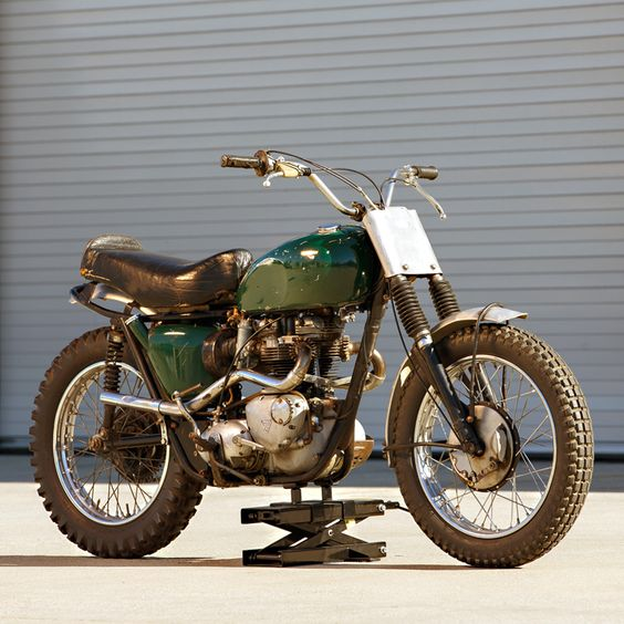 Utter the names Bud Ekins and Steve McQueen and you'll immediately have a captive audience. The stuntman-and-star duo created the most iconic motorcycle stunt in Hollywood history and regularly competed for glory on two wheels. Three days ago, this 1963 Triumph Bonneville desert sled, built by Ekins and piloted by the King of Cool himself, sold at Bonhams in Vegas for a staggering $103,500. (That's nearly $20,000 more than a previous sale price of $84,240 in 2009.)
