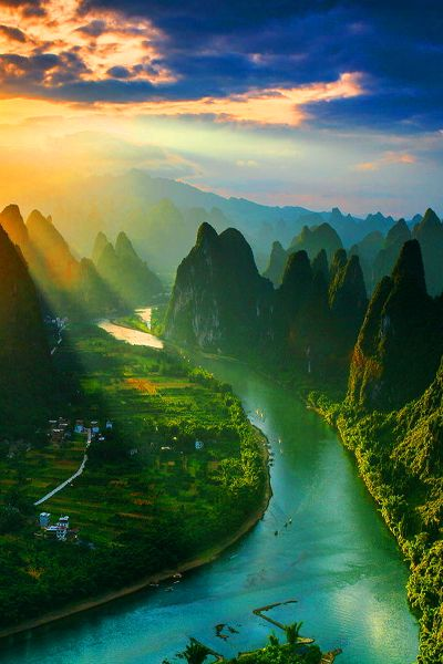 vacationinparadise: Watching the sunrise from the top of Mount Xiang Gong (Guilin of China). Sunrise by Tian Ma