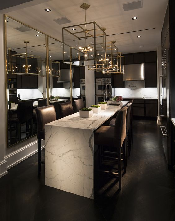 A gorgeous kitchen with rich brown wood and stunning lanterns to give it warmth with a whole lot of contemporary.