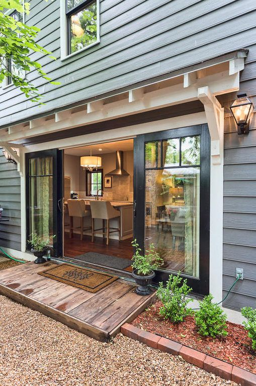 Beautiful 1920s House Tour - love how these custom sliding doors open so wide.