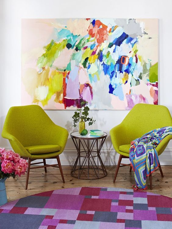 beautiful mix of colors, contemporary but still inviting, maybe try table like this by swivel chair.