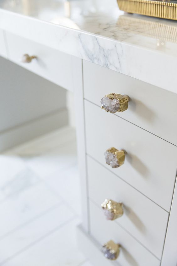 Cabinet knobs are the Crowned Quartz Knob by Anthropologie.  Alice Lane Home.