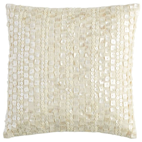 Covered in small pieces of mother of pearl, our decorative pillow boasts a coastal elegance with a little bit of glam. The striking shells catch and reflect the light, bringing the infinite beauty of the beach right into your living space.