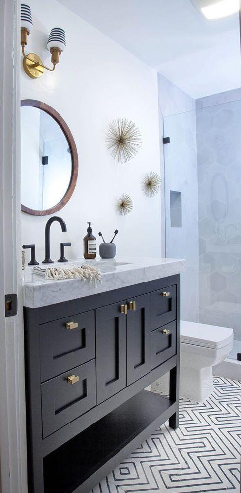 Dark wood and light marble bathroom vanity