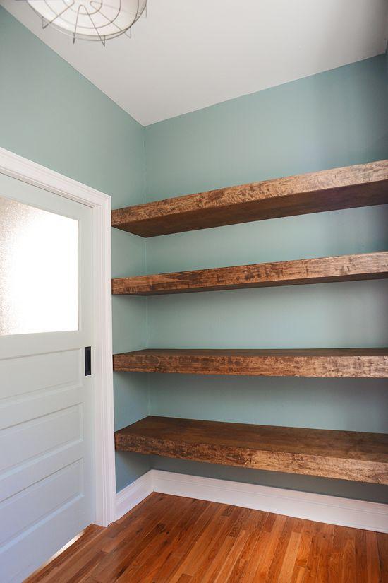 DIY floating wood shelves in the workshop! // via Yellow Brick Home