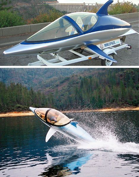 Dolphin shaped power boat!  I so want one of these!