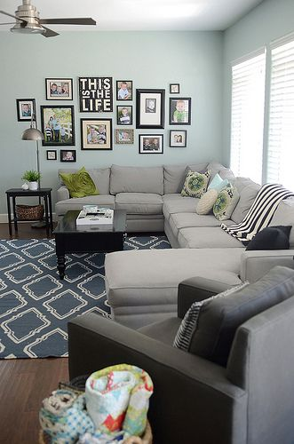 EXACTLY what I want for the living room (reversed)! Sectional couch against  And family photos on side wall :D