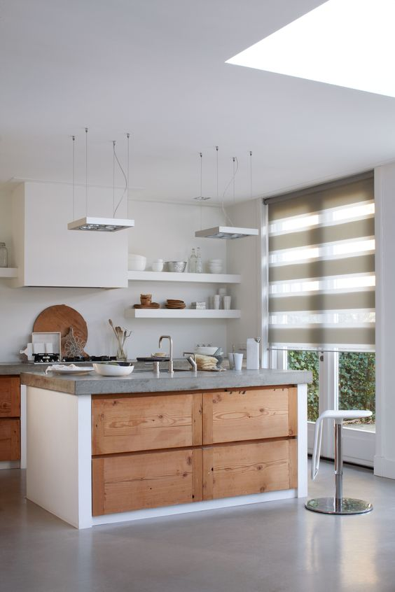 Filter light with sheer roller shades featuring large vanes in a half-open position.