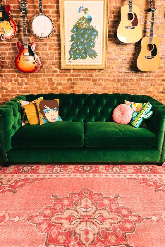 green velvet tufted sofa and pink rug