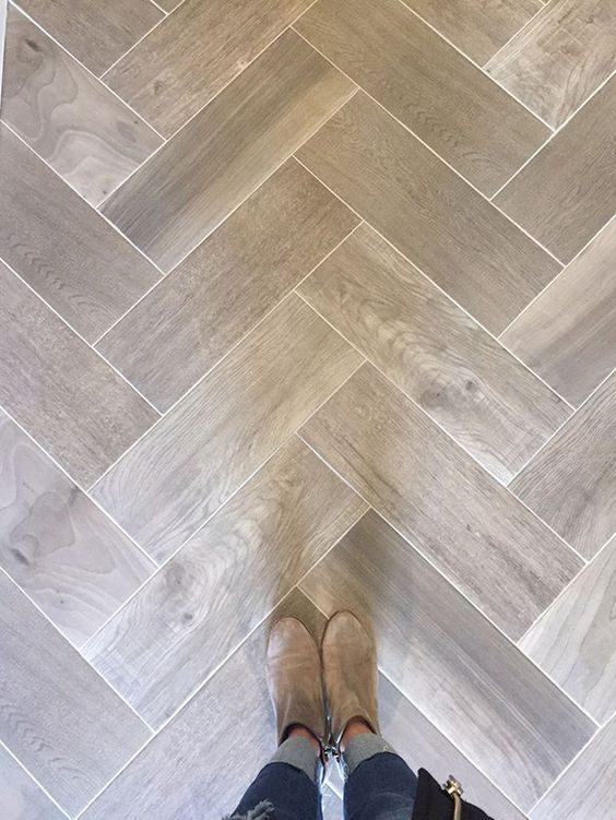 Love wood tile in a herringbone pattern. Such a great look and SO DURABLE! (@Floor & Decor)