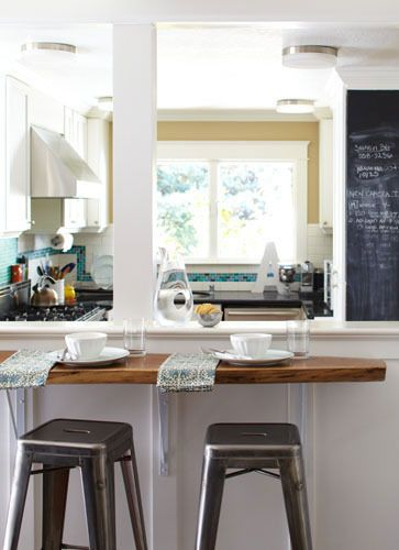 Nice breakfast nook if we tear down the wall between the kitchen and dining room. From apartment therapy
