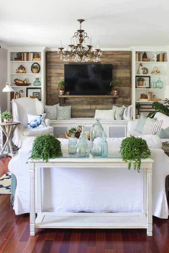 Rustic coastal living room for summer with white, aqua, and fresh plants