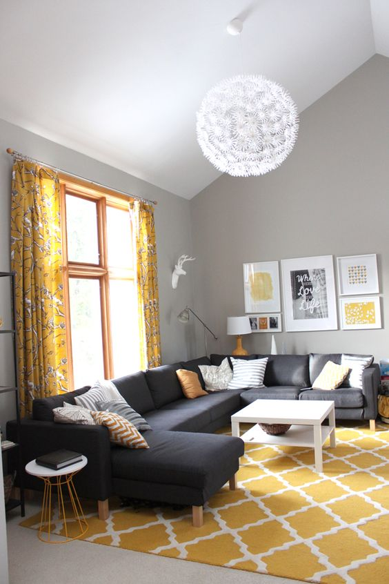 / sherwin williams mindful gray + tall ceilings! I love this couch but I'm not a fan of the yellow accent pieces! I think it would look a lot better with cooler colors!