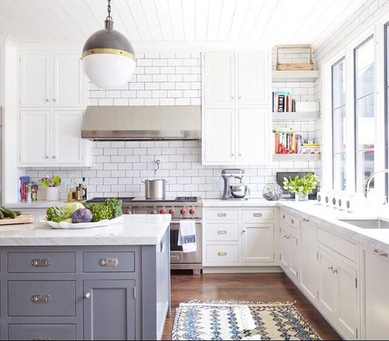 So many great details in this kitchen from the white subway tiles, to the marble countertops, open shelving and all that natural light! What is your favourite?   Designed by Bonadies Architect @bonadiesarchitect #bonadiesarchitect #interiordesign