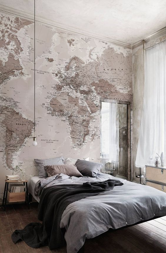 Soft neutrals work a dream in this bedroom. This world map wallpaper adds a stylish and elegant look to any room.