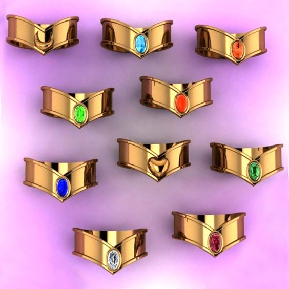 These Sailor Moon inspired tiara rings are the reason why you have ten fingers! All ten of the Sailor Scout's are available in a shiny, finger-sized tiara with your respective choice of gemstone and metal ring band.