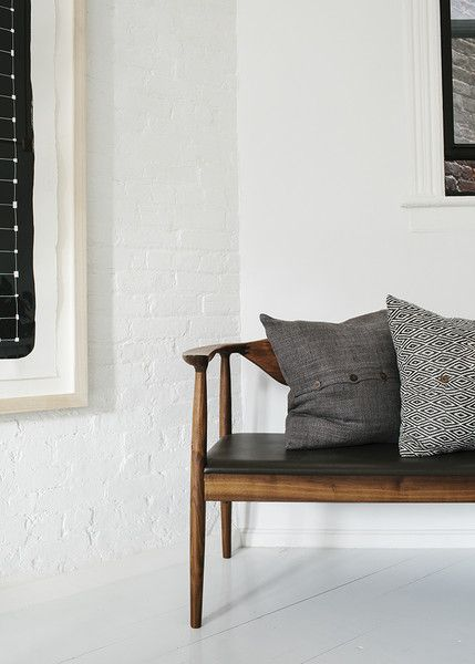 Contemporary Modern Vintage Details: Patterned pillows atop vintage wooden