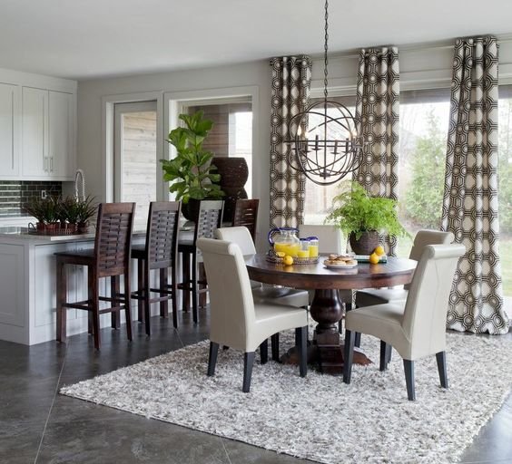 Dining Room | Geometric Circle Drapery Panels, Beige Leather Dining Chairs, Dark Wood Round Pedestal Dining Table
