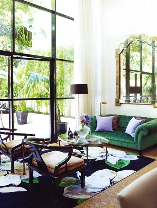 gorgeous living room, green couch, black windows, mirror
