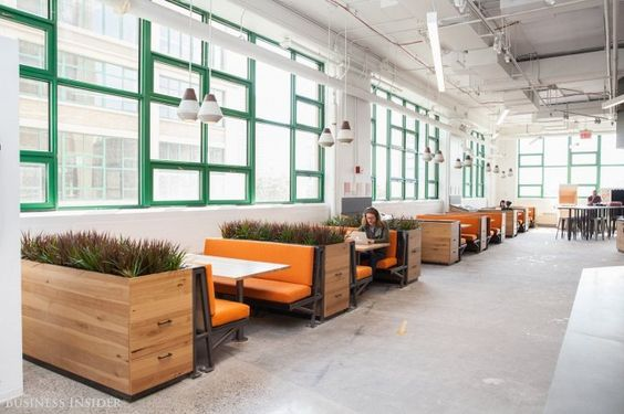 Open workspace with green window seals and orange booths