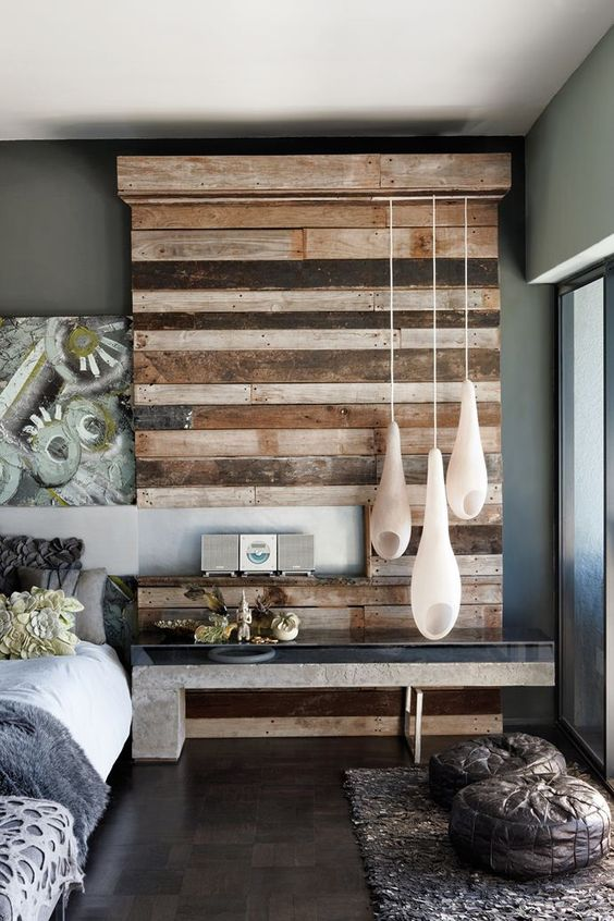 Reclaimed crate wood has been turned into a textured feature in the bedroom. Concrete table and pod lights complete the feature. Micky Hoyle's house.