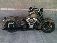 A custom Harley-Davidson motorcycle was built for Tombstone Harley-Davidson by a team at Harley-Davidson of Tucson. The bike features a rustic, western look complete with a saddle fitted for holding bullets and a gun. The bike itself is a 2006 Springer Classic, which was chosen because it already has an older look to it.