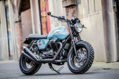Beautiful custom Moto Guzzi V7 II Special by Moto Strada inpspired by Steve McQueen and the legendary Porsche Gulf from the Le Mans races.