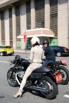 Beautiful girl styling on a Moto Guzzi V7 Classic.