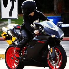 Black and Red  a chick riding it! guys i just realized this was justin  wowwww