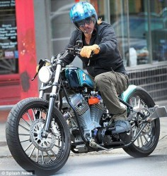 Brad Pitt on Motorcycle. Yes.