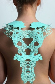 by Jasmine Bowden | Laser cut paper back jewellery inspired by sea forms. | Photography by James Mann.
