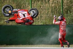 Ducati's Mika Kallio of Finland reacts after crashing during the classification session for the Czech Grand Prix.